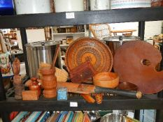 A shelf of old wooden items.