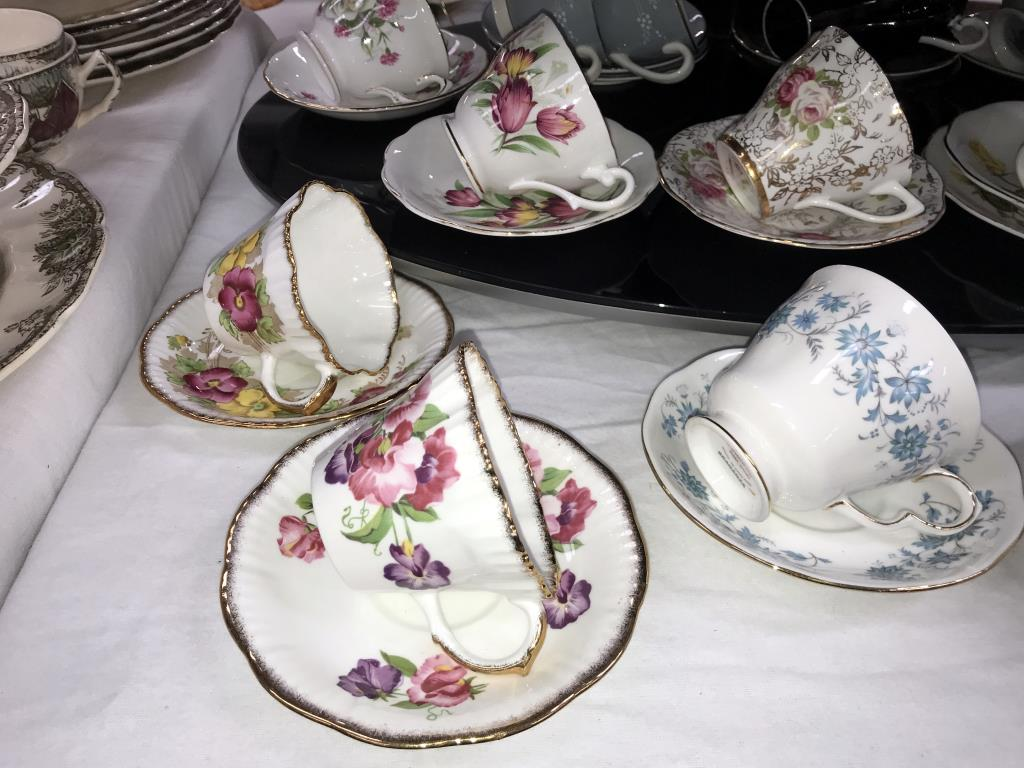 A quantity of porcelain trio's & cups & saucers including Royal Albert etc. - Image 6 of 7