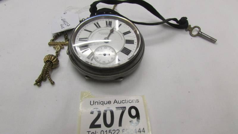 A silver pocket watch marked Fattorini & Sons, Bradford.