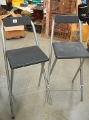 A pair of folding work bench chairs.