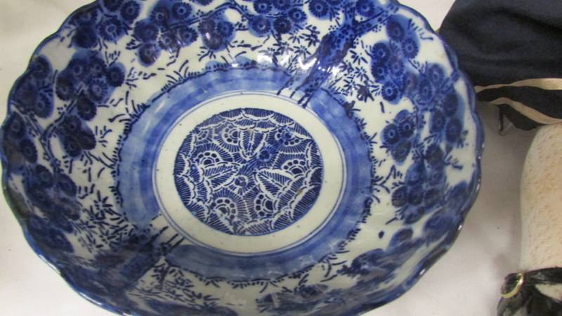 A 31 cm diameter Chinese blue and white plate together with a 19 cm diameter bowl. - Image 2 of 4