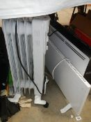 Three good clean electric heaters.