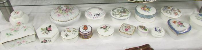 Approximately 16 trinket/pill boxes.