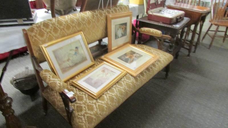A mahogany framed sofa with string inlay.