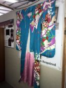 A large/over sized blue/floral Chinese Kimono