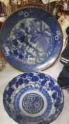 A 31 cm diameter Chinese blue and white plate together with a 19 cm diameter bowl.