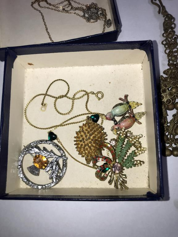 A 9ct gold pendant, a silver necklace & a quantity of brooches etc. - Image 4 of 4