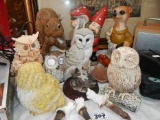 A quantity of animal garden ornaments including owls.