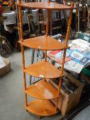 A five shelf oak corner unit.