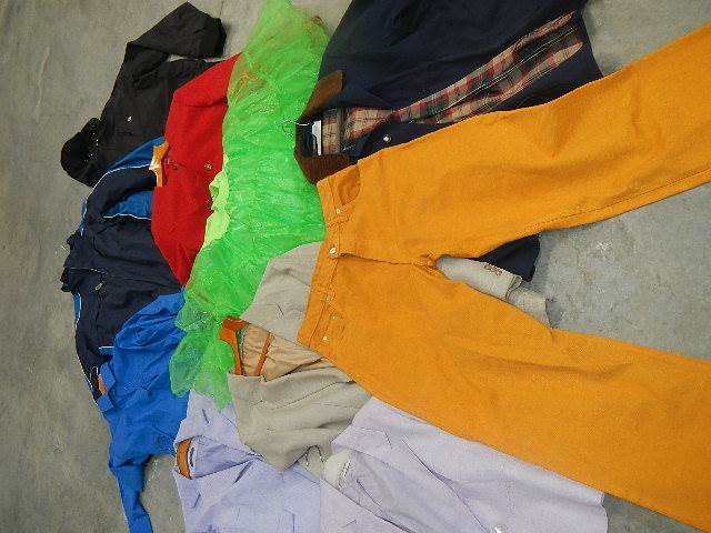 A rail of assorted suits, jackets and other clothing. - Image 9 of 11