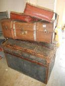 Two cabin trunks and three satchels.