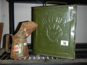 A vintage Shell petrol can and an old oil can.