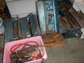 4 metal tool boxes and a large quantity of tools.