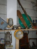 A mixed lot including tins, hurricane lamp etc.