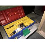 A box of fishing tackle including charter surf 6500 reel