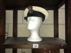 A vintage Naval cap size 6 and 3/4