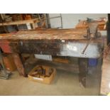 A large work bench with vice.