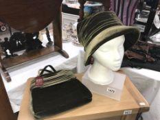 A sage coloured hat & matching handbag by Dents,