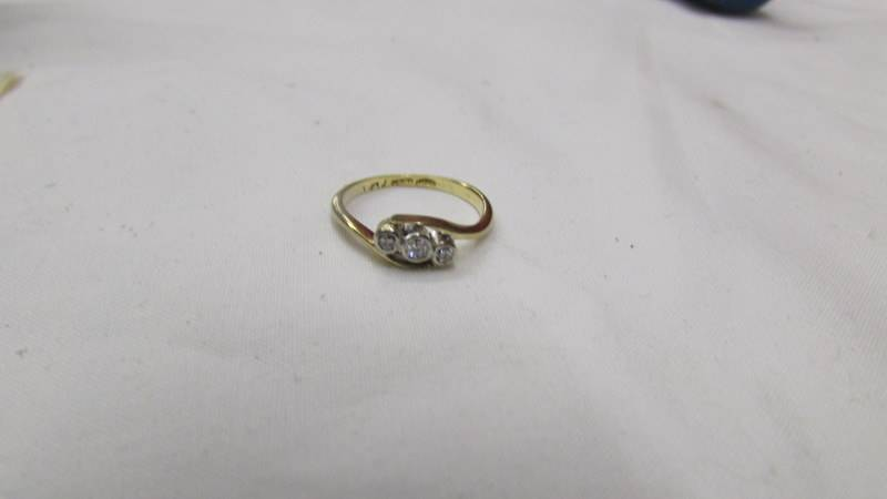 An old cut diamond three stone ring in a twist design, circa 1940's, stamped 18ct/plat. Size H. - Image 2 of 2