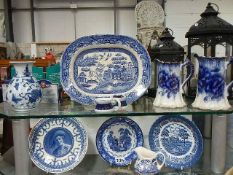 A mixed lot of blue and white plates, jugs etc.