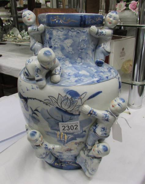 A blue and white oriental vase.