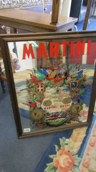 A large Martini advertising mirror mounted in a stained wooden frame, circa 1970s.