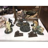 A selection of cast iron door stops including Judy & cricketer etc.