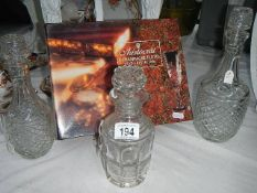Three glass decanters and a boxed set of 4 champagne flutes.