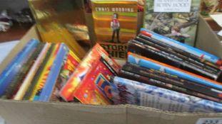 A box of children's books.