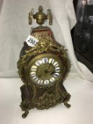 A superb quality buelle mantel clock. in good condition.