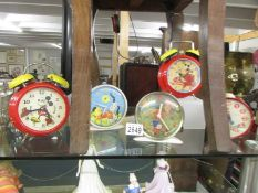 Five vintage novelty clocks including Mickey Mouse, Noddy, Sooty and Sweep etc.