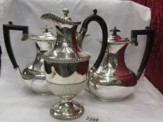 Two silver plate teapots and a silver plate coffee pot.