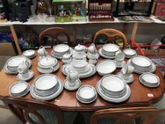 In excess of 85 pieces of Noritake Doral Blue pattern tea and dinner ware (12 place setting but