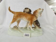 A pair of mid 20th century Royal Dux hunting dogs, in good condition.