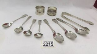 A mixed lot of silver spoons, napkin rings, approximately 200 grams.