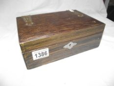 An oak box of miscellaneous including pocket knives, silver topped pot,