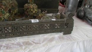 A cast iron fire curb, 110 cm wide by 20 cm deep.