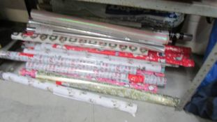 Several rolls of wrapping paper.