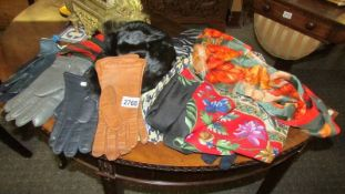 A quantity of vintage scarves, gloves etc.