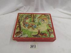 A child's wooden puzzle block set in good condition for age.