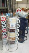 Four sets of mugs including three on stands.