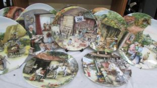 12 Royal Doulton collector's plates.