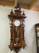 A Victorian twin weight mahogany Vienna wall clock, the case surmounted with horses,