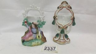 Two ceramic pocket watch stands.