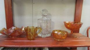 A cut glass decanter (stopper chipped at base) and 4 pieces of amber carnival glass