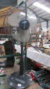 A pedestal fan, in working order,