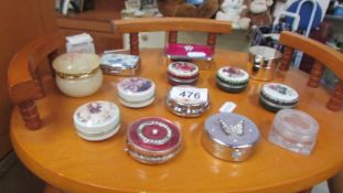 A mixed lot of pill boxes.