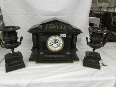A 19th century Palladian style clock garniture with bronze urn side pieces, Bennetfink & Co.