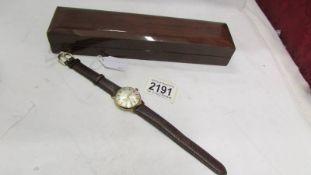 A 9ct gold Garrard gent's wrist watch in good working order.