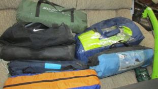 A quantity of camping equipment including tents.